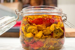 Dried tomatoes in glass jar. Homemade dried tomatoes in glass jar Stock Photos