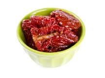 Dried tomatoes in green bowl Royalty Free Stock Photography