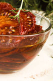 Dried tomatoes with olive oil Stock Photo
