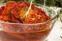 Dried tomatoes with olive oil Royalty Free Stock Photography