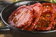 Dried tomatoes with olive oil. Sun dried tomatoes with olive oil Stock Photography