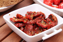 Dried tomatoes, olives and peppers royalty free stock photography