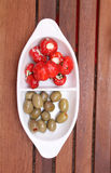 Dried tomatoes, olives and peppers royalty free stock photos