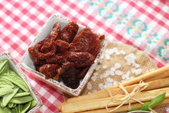 Dried tomatoes, salty sticks, italian food Stock Images
