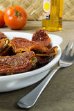 Dried tomatoes in white bowl Stock Image