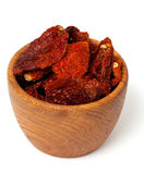 Dried tomatoes in a wooden bowl Royalty Free Stock Photos