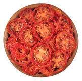Dried tomatoes in a wooden bowl on a white Stock Photos
