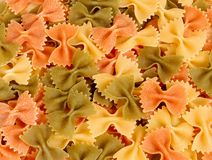 Dried tri-colored farfalle pasta. Colorful dried tri-colored farfalle pasta Stock Photography