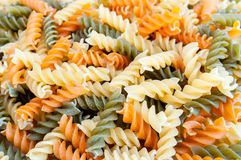 Dried tricolore fusilli pasta. Close up background Royalty Free Stock Photo