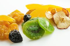 Dried tropical fruits mix. Dried sweet tropical fruits mix isolated over white background Stock Photos