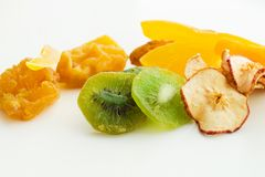Dried tropical fruits mix. Dried sweet tropical fruits mix isolated over white background Stock Image