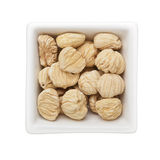 Dried unshelled chestnut Stock Images