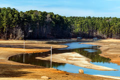 Dried up lake with docks on ground Royalty Free Stock Photo