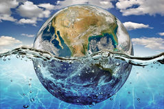 Dried up planet immersed in the waters of world ocean Stock Images