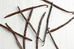 Dried vanilla sticks. On light wooden background Royalty Free Stock Photography