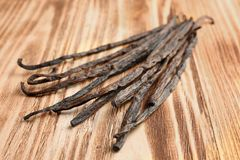 Free Dried Vanilla Sticks On Wooden Background Stock Images - 110753374