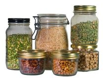 Dried Vegetables. Various dried vegetables stored in glass jars Royalty Free Stock Images