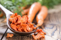 Dried vegetables (Carrots) on wood Royalty Free Stock Photo