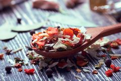 Dried vegetables in a wooden spoon. On the kitchen table royalty free stock photos