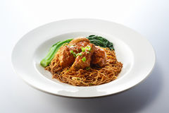 Dried Wanton Noodle with Curry Chicken. Isolated Dried Wanton Noodle with Curry Chicken in White Background Stock Photo