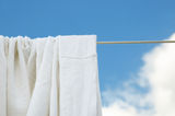 Dried washed bed sheets stock photos