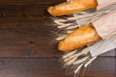 Dried wheat stalks in between french bread Royalty Free Stock Image