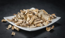Dried white Mushrooms on a slate slab, selective focus. Some Dried white Mushrooms on a vintage slate slab, selective focus stock image