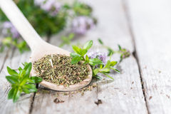 Dried Winter Savory on a cooking spoon Stock Image