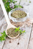 Dried Winter Savory on a cooking spoon Stock Images