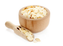 Dried yellow pea flakes in wooden bowl Royalty Free Stock Photo