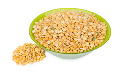 Dried yellow peas in green glass bowl Stock Photo