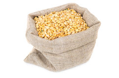 Dried yellow peas in sackcloth bag isolated on white Royalty Free Stock Photography