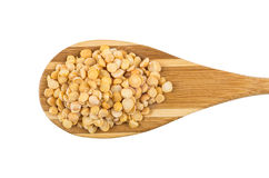 Dried yellow peas in wooden spoon isolated on white background Royalty Free Stock Photos