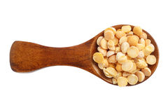 Dried yellow peas in wooden spoon isolated on white background. Top view.  Stock Photo