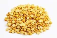 Dried Yellow Split Peas. Raw Dried Yellow Split Peas on white Royalty Free Stock Images