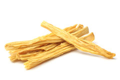Dried yuba sticks or Fuzhu. On white background Stock Photo