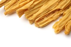 Dried yuba sticks or Fuzhu. On white background Stock Photos