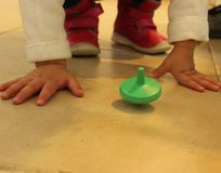 Jewish traditional chanuka toy. Children playing with colorful driedles. Stock Image