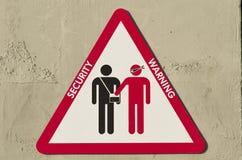 Driehoekig teken om over het risico te waarschuwen om worden geroofd Stock Fotografie