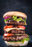 Drievoudige hamburger Stock Foto's