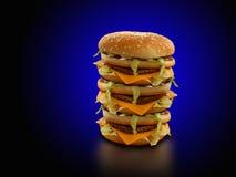 Drievoudige kaashamburger Stock Afbeeldingen