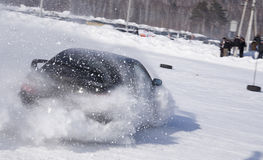 A sport car which is drifting in the cloud of snow Royalty Free Stock Photo