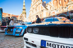 Drift Allstars parade on Hall Square. People watching for three BMW drift cars on Hall Square after street parade, Riga, Latvia, 31.07.2015 Royalty Free Stock Photos