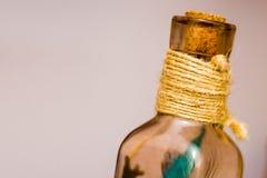 Drift bottle. On the floor Royalty Free Stock Images