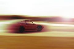 Drift car blur sunrise or sunset Stock Photos