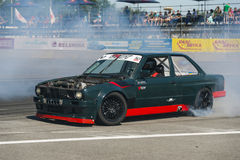Drift car brand BMW without hood overcomes the track Royalty Free Stock Images