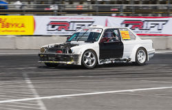 Drift car brand BMW without hood overcomes the track Royalty Free Stock Photography