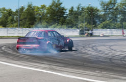 Drift car brand Ford overcome turn track Royalty Free Stock Image
