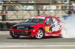 Drift car brand Ford overcome turn track royalty free stock photo
