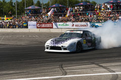 Drift car brand Nissan overcome turn track Stock Photo